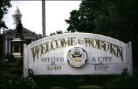 "A sign reading ""Welcome to Woburn"""